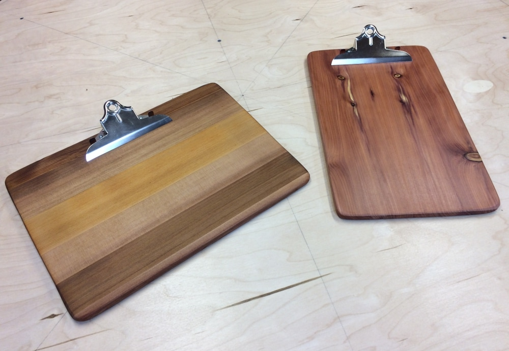 Landscape and portrait style clipboards made from old wooden playsets.